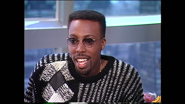 """everything bills you as a happy guy. are you a happy guy? hall: yeah. yeah, people tease me about smiling all the time and being happy, being """"the... - arsenio hall stock videos & royalty-free footage"""