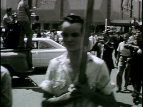 Reporter interviews pro-segregationist Bobby Joiner at a civil rights demonstration
