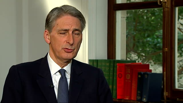 reporter james foley beheaded by islamic state terrorist group; england: london: westminster: int philip hammond mp interview sot - we will certainly... - isis beheading stock-videos und b-roll-filmmaterial