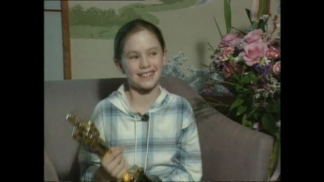 Reporter Jim Mora querying a young Anna Paquin with Academy Award the day after winning the Oscar for Best Supporting Actress for her role in the...