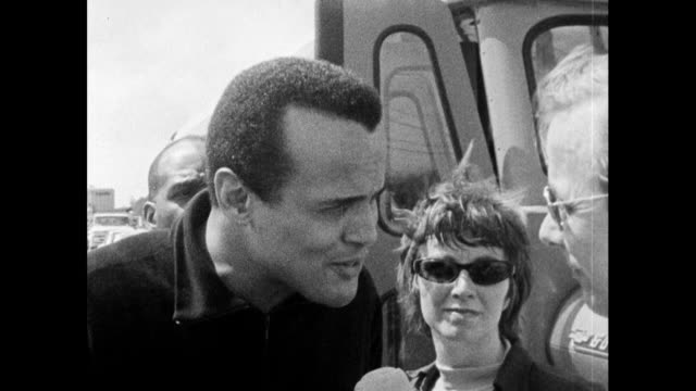 vídeos de stock, filmes e b-roll de reporter, john tidmarsh, interviews harry belafonte on his involvement with the selma to montgomery marches and organising the stars for freedom... - 1965
