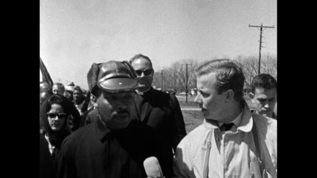 reporter, john tidmarsh interviews martin luther king during the march from selma to montgomery; 22nd march 1965. jt questions whether governor... - in front of stock videos & royalty-free footage