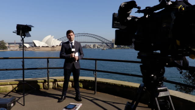Reporter live cross at Sydney Harbour