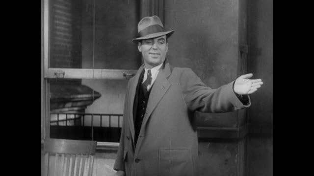 1931 reporter makes dramatic exit from pressroom as he leaves his job - 1931 stock videos & royalty-free footage