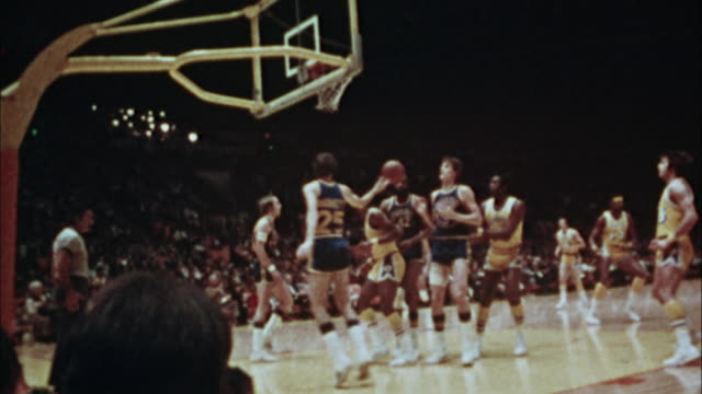 ms, pan, reporter photographing basketball match,1970's, los angeles, california, usa - match sport stock videos & royalty-free footage