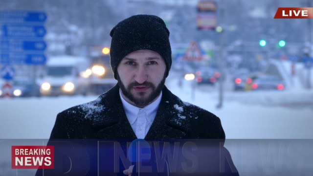 TV reporter presenting actual snow situation in town