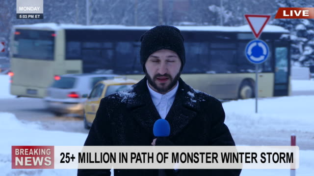TV reporter presenting snow situation in town