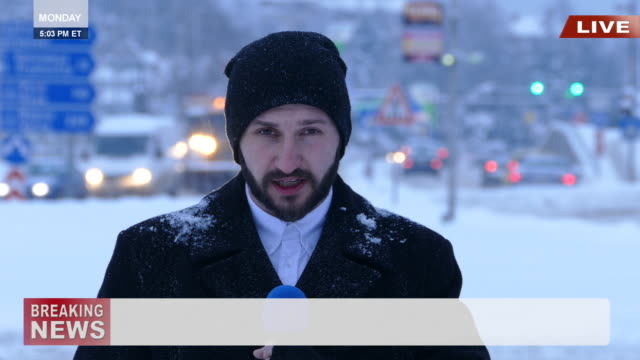 TV reporter presenting the snow situation in town