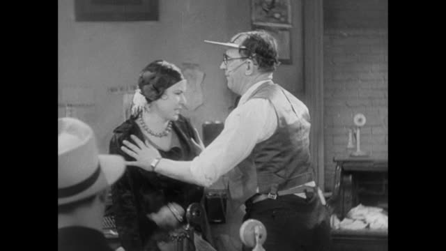 1931 reporter pushes emotional woman out of press room, killing the mood - 1931 stock videos & royalty-free footage