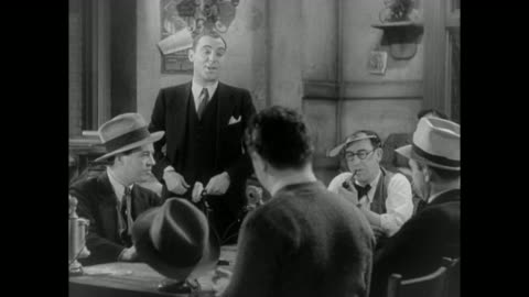 1931 reporter shows cash from new job to old coworkers - 1931 stock videos & royalty-free footage