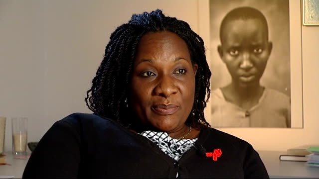 reporter through offices of tear fund charity with hope siwale and unidentified woman blackburn ext adrienne seed along through field with her son ben - lancashire stock videos and b-roll footage