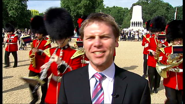 reporter to camera as band of coldstream guards march past playing sot coldstream band marching as they play coldstream guards bandsman playing hey... - trombone stock videos & royalty-free footage