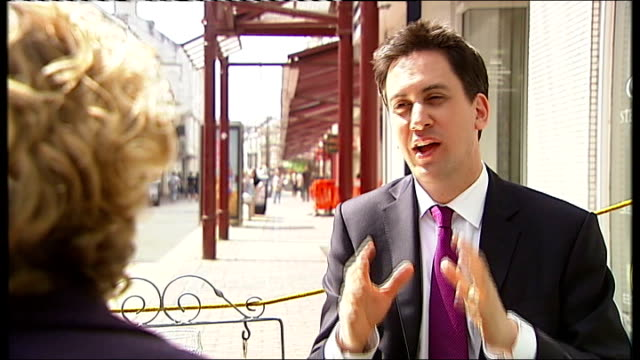 reporter to camera back view of press filming miliband seated with itn reporter itn reporter listening to miliband miliband speaking with itn... - water bird stock videos & royalty-free footage