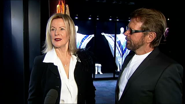 reporter to camera bjorn ulvaeus and annifrid lyngstad interview sot cutaways poster of annifrid / poster of abba / white satin costumes and platform... - platform shoe stock videos and b-roll footage