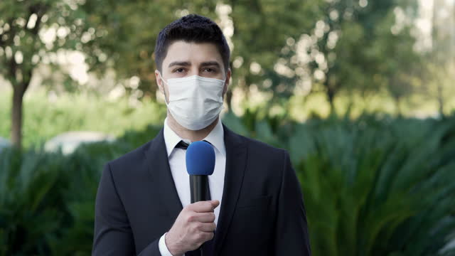 tv reporter wearing a face mask - tv reporter stock videos & royalty-free footage