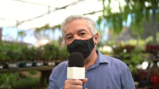 tv reporter wearing a mask talking - pov of camera - tv reporter stock videos & royalty-free footage