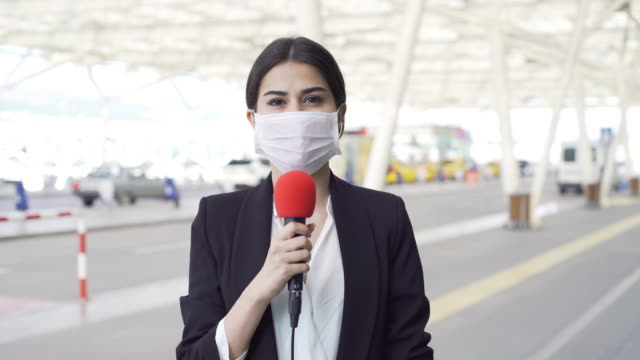tv reporter wearing a mask - journalist video stock e b–roll