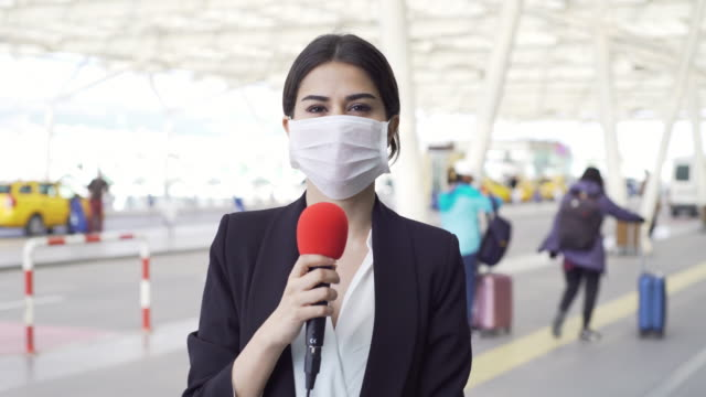 tv reporter wearing a mask - media occupation stock videos & royalty-free footage