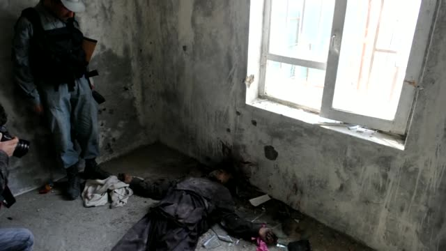 reporters are shown on monday the building in which afghan forces killed taliban militants who launched one of the biggest attacks on the capital in... - taliban stock videos & royalty-free footage