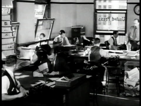 reporters at desks in united press office many press reporters clustered at tables typing on typewriters - 1935 stock videos and b-roll footage