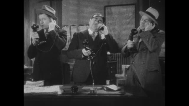 1931 reporters eugene pallette, stuart erwin, and richard 'skeets' gallagher answer phone alternating 'yes,' 'no' and 'maybe' answers before editor gary cooper sternly inquires about workload - 1931 stock videos & royalty-free footage