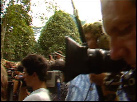 vídeos y material grabado en eventos de stock de reporters film sting in the amazon at a press conference with raoni metuktire and kayapo indians - yanomami