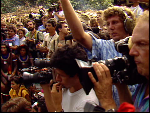 reporters film sting in the amazon at a press conference with raoni metuktire and kayapo indians - yanomami stock videos and b-roll footage