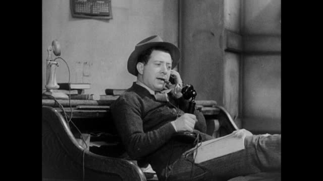 1931 reporters make sexist remarks and jokes while on telephone to source - sex discrimination stock videos & royalty-free footage
