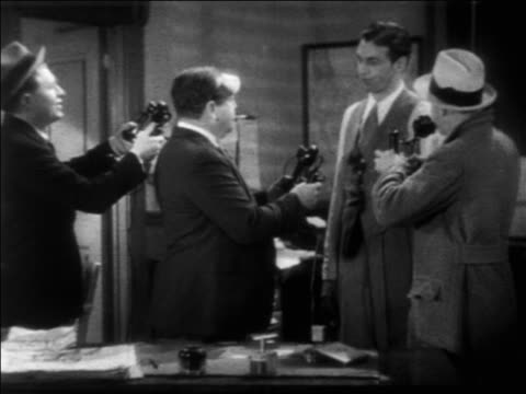 reporters on telephones / reporter enters / woman + man enter / feature - 1931 stock videos & royalty-free footage