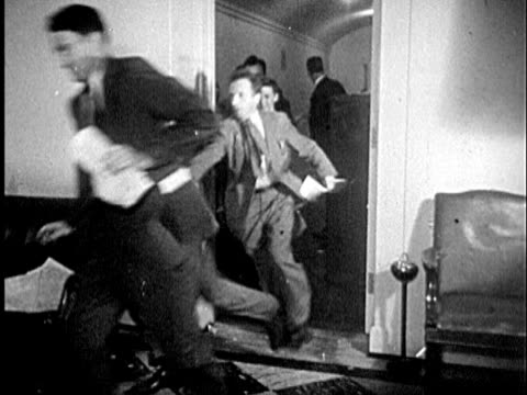 1945 B/W WS Reporters running to press conference / United States
