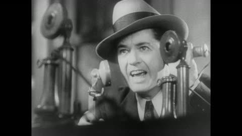 1931 reporters rush to phones to report jailbreak including recently resigned reporter - journalist bildbanksvideor och videomaterial från bakom kulisserna