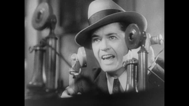 stockvideo's en b-roll-footage met 1931 reporters rush to phones to report jailbreak including recently resigned reporter - 1930
