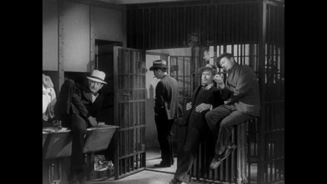 1931 Reporters stand outside jail cell waiting for news of injured woman