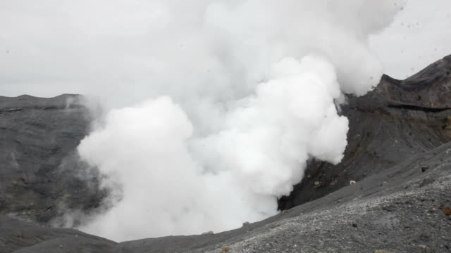 reporters were allowed to inch closer to the nakadake peak of mount aso on february 8 japan after the alert level was lowered to 1 the day before the... - erupting stock videos & royalty-free footage
