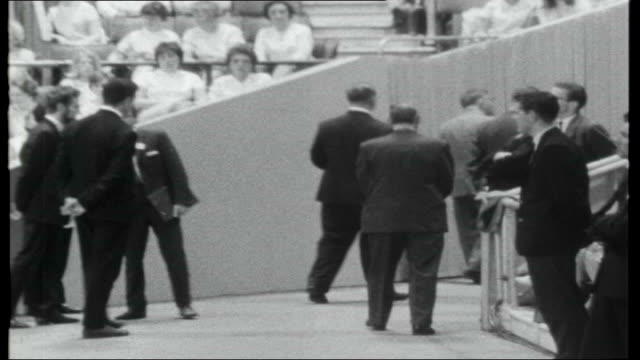 billy graham's greater london crusade; cameraman filming graham speak graham preaching with intermittent shots of various members of audience sot... - earls court stock videos & royalty-free footage