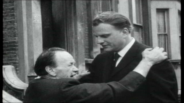 billy graham's greater london crusade; england: london: brixton: ext graham meets strange old man who had been attacked by dogs and asks him to find... - greater london stock videos & royalty-free footage