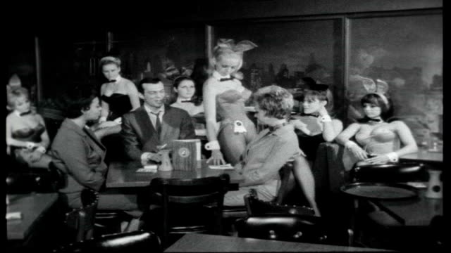 british bunny girls being trained in playboy club / hugh hefner interview usa chicago playboy club int good shots of women wearing bunny costumes... - hugh hefner stock videos & royalty-free footage