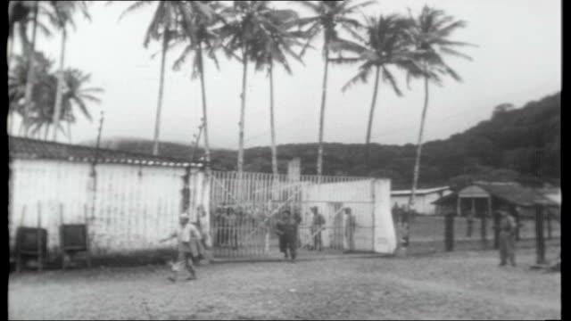 columbia: gorgona island prison; columbia: gorgona island prison: ext gorgona penitentiary seen from hill / armed guard walking along cat-walk on... - prison guard stock videos & royalty-free footage