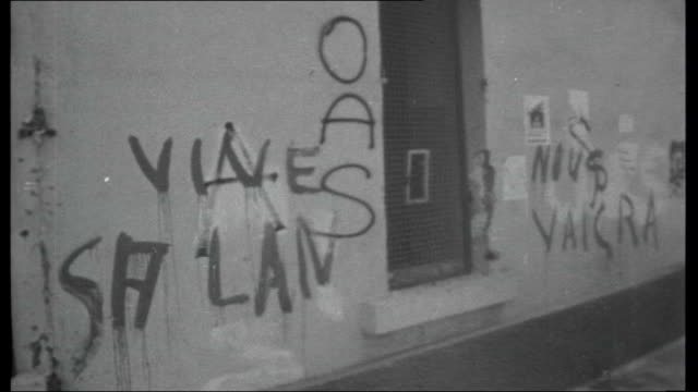 de gaulle attempts devaluation of the pound 951962 algeria oran ext troops and tanks in street along trailed by children / grafitti / armed soldier /... - devaluation stock videos and b-roll footage
