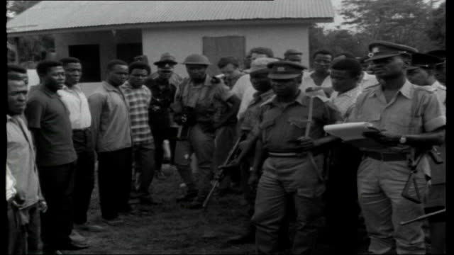 ghana after coup; travelling shot along road to communist guerrilla training camp for africans, closed by the new regime. gall along with men in... - coup d'état stock videos & royalty-free footage