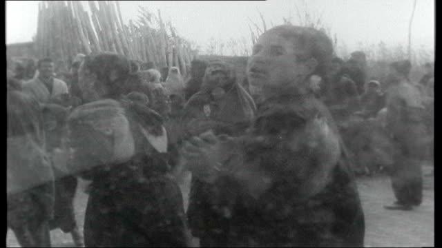 northern iraq: kurdistan war; iraq: kurdistan: ext reporter driving through persia into area known unofficially as kurdistan, passing military... - クルド人点の映像素材/bロール