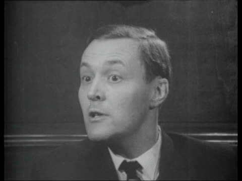 vídeos de stock, filmes e b-roll de pirate radio stations ext big ben and houses of parliament tony benn mp interview sot copy of european agreement for prevention of broadcasts... - tony benn
