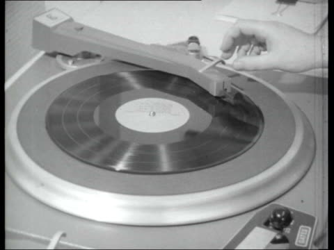 vídeos y material grabado en eventos de stock de pirate radio stations hand lifting arm of record player then placing needle on record / record playing sot / hand turning dial / sign ' isle of man... - posicionamiento