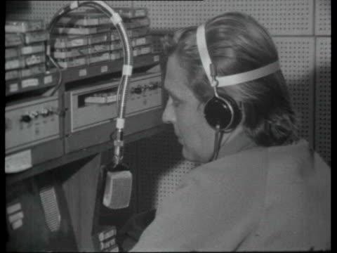 pirate radio stations int radio london disc jockey broadcasting from studio on board ship sot / record on turntable / varioius of studio engineers... - radio stock videos and b-roll footage
