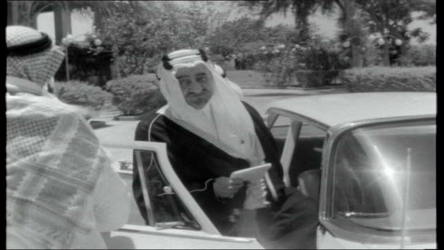 saudi arabia under king faisal's rule; saudi arabia: jeddah: int king faisal of saudi arabia looking into camera king faisal working at his desk... - jiddah stock videos & royalty-free footage