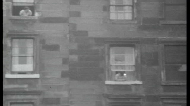 scotland redundancies at rootes car plant scotland glasgow ext slums of glasgow tenement buildings children playing with dead rat / derelict housing... - 1966 stock-videos und b-roll-filmmaterial