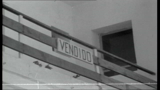 vidéos et rushes de search for missing hbomb after b52 plane crash in spain waves lapping on coast line empty modern building of holiday flats sign for apartments pan... - 1966