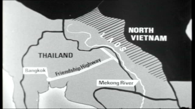 Thailand Communist threat THAILAND EXT Boat on Mekong River / People wading through water as boarding boat / Mountains and jungle across river / Map...