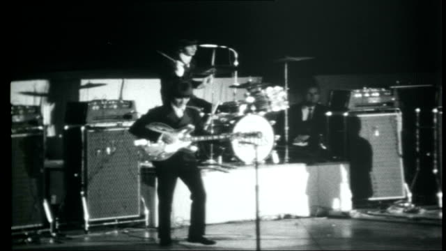 the beatles across america beatles performing on stage at concert sot - 1966 stock-videos und b-roll-filmmaterial