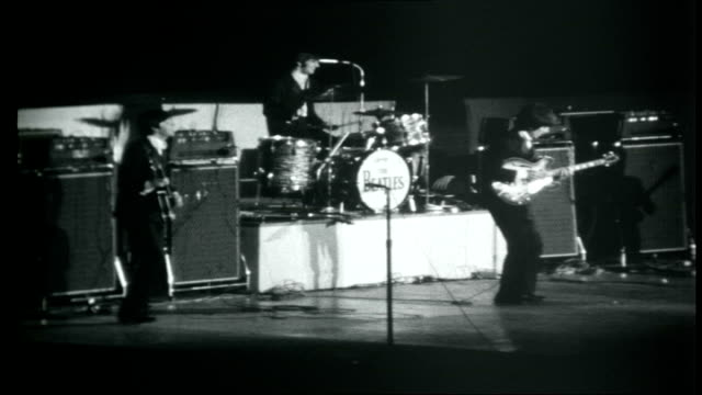 the beatles across america beatles performing on stage in front of screaming fans sot - 1966 stock-videos und b-roll-filmmaterial
